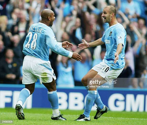 Trevor Sinclair of Man City celebrates with Antoine Sibierski after his shot is put in by Lauren of Arsenal during the FA Barclaycard Premiership...