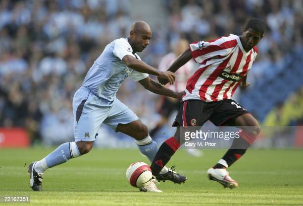 Trevor Sinclair of Manchester City and Claude Davis of Sheffield United in action during the Barclays Premiership match between Manchester City and...