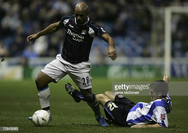 Trevor Sinclair of Manchester City is tackled by Tommy Spur of Sheffield Wednesday during the FA Cup sponsored by EON Third Round match between...