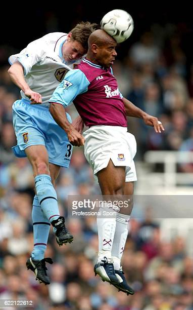 Trevor Sinclair of West Ham United clashes with Rob Edwards of Aston Villa during the FA Barclaycard Premiership match between West Ham United and...