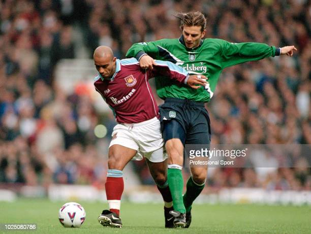 Trevor Sinclair of West Ham United holds off the challenge from Patrick Berger of Liverpool during an FA Carling Premiership match at Upton Park on...