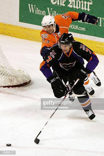 Trevor Smith of the Bridgeport Sound Tigers challenges Nate Guenin of the Philadelphia Phantoms for the puck during the first period on January 23,...