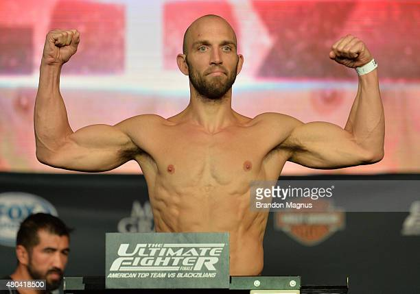 Trevor Smith steps onto the scale during the TUF 21 Finale Weighin at the UFC Fan Expo in the Sands Expo and Convention Center on July 11 2015 in Las...
