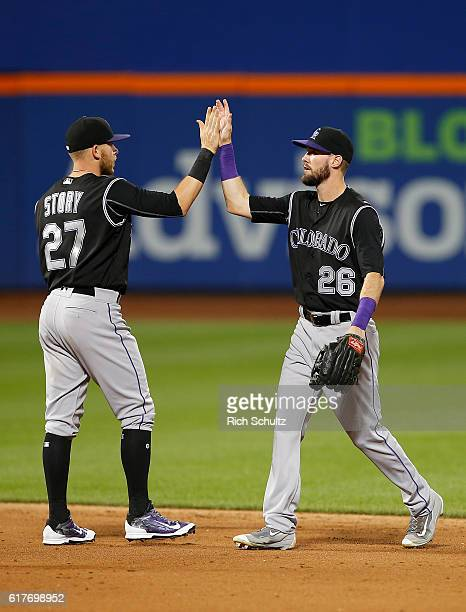 Trevor Story and David Dahl of the Colorado Rockies congratulate each other after defeating the New York Mets 61 in a game at Citi Field on July 29...