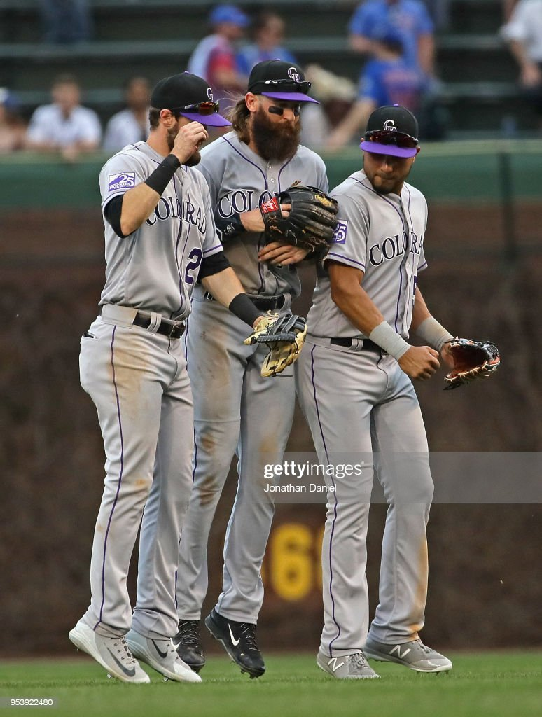 Trevor Story #27, Charlie Blackmon #19 and Noel Cuevas #56 of the Colorado Rockies celebrate a win over the Chicago Cubs at Wrigley Field on May 2, 2018 in Chicago, Illinois. The Rockies defeated the Cubs 11-2.