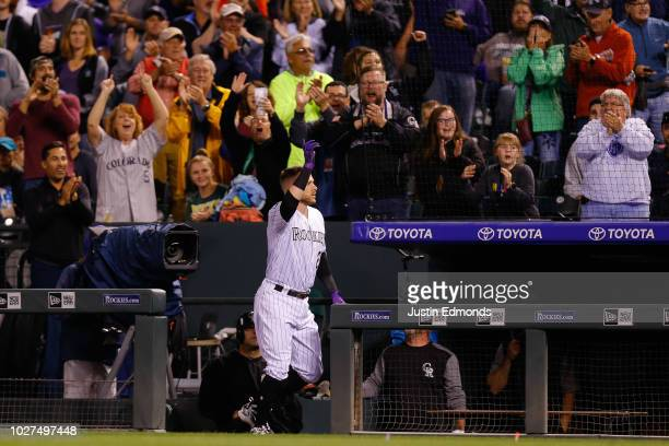 Trevor Story of the Colorado Rockies acknowledges the crowd with a curtain call after his third home run of the night against the San Francisco...