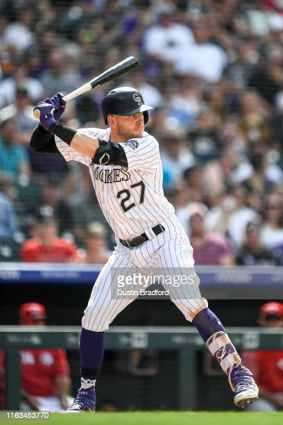 Trevor Story of the Colorado Rockies bats against the Cincinnati Reds during a game at Coors Field on July 14 2019 in Denver Colorado