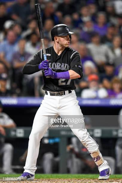 Trevor Story of the Colorado Rockies bats against the Miami Marlins at Coors Field on August 16 2019 in Denver Colorado