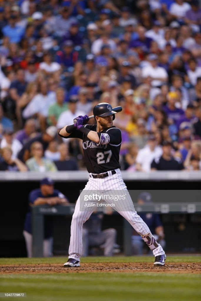 trevor story of the colorado rockies bats during a game against the