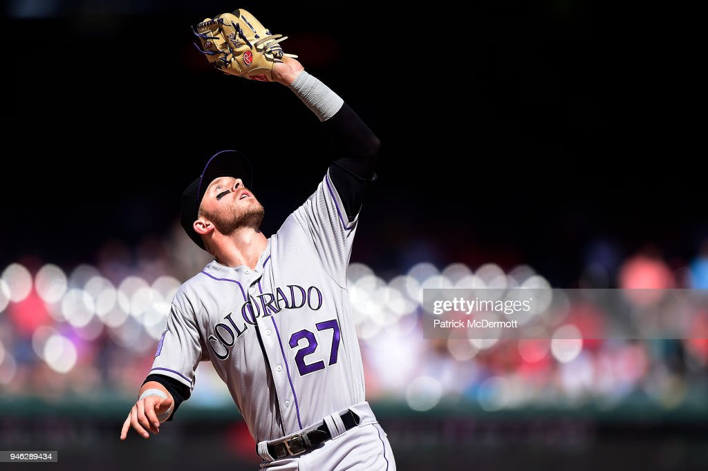 Trevor Story #27 of the Colorado Rockies catches a fly ball hit by Matt Wieters #32 of the Washington Nationals (not pictured) for the final out of the seventh inning at Nationals Park on April 14, 2018 in Washington, DC.