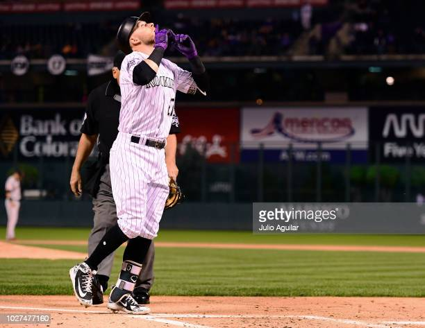 Trevor Story of the Colorado Rockies celebrates after a home run in the first inning of a baseball game against the San Francisco Giants on September...