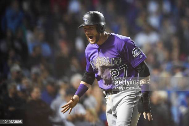 Trevor Story of the Colorado Rockies celebrates after scoring a run in the thirteenth inning to give the Rockies a 21 lead against the Chicago Cubs...