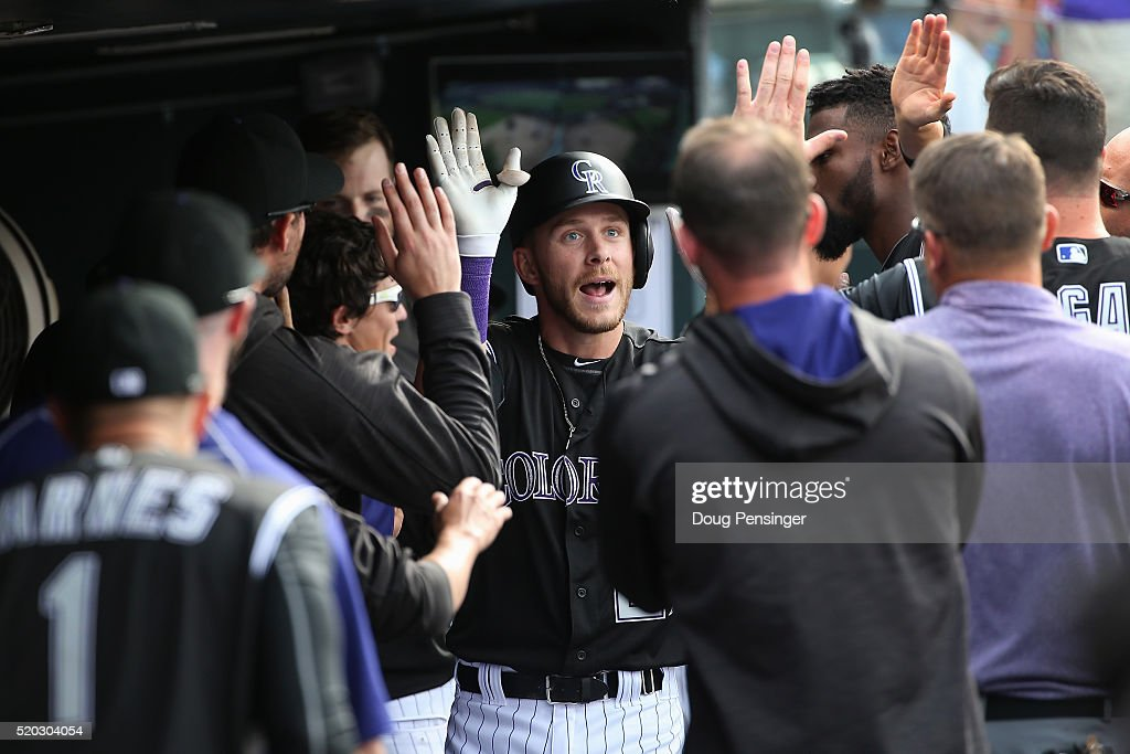 Trevor Story #27 of the Colorado Rockies celebrates his solo home run off of Brandon Maurer #37 of the San Diego Padres to take a 5-3 lead in the eighth inning on April 10, 2016 in Denver, Colorado. Story set a Major League record as he hit his seventh home run through the first six games of the season as the Rockies defeated the Padres 6-3.
