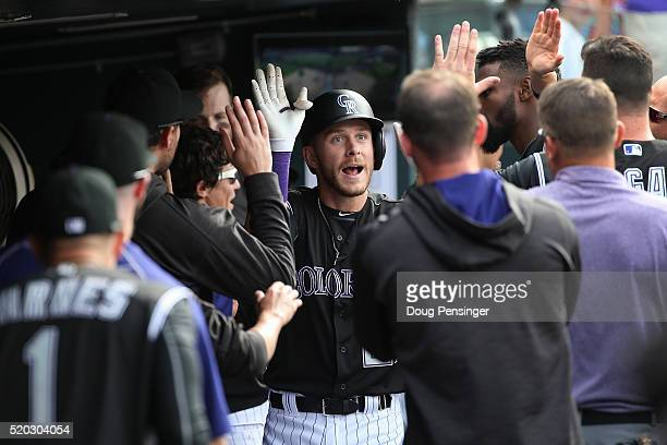 Trevor Story of the Colorado Rockies celebrates his solo home run off of Brandon Maurer of the San Diego Padres to take a 5-3 lead in the eighth...