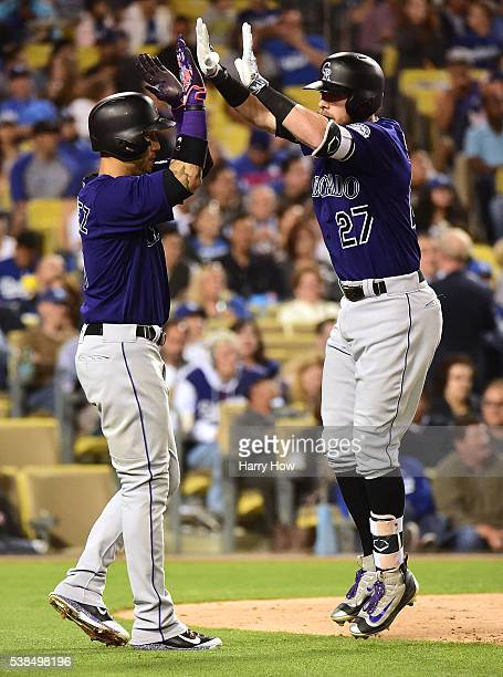 Trevor Story of the Colorado Rockies celebrates his three run homerun to take a 61 lead over the Los Angeles Dodgers with Carlos Gonzalez during the...