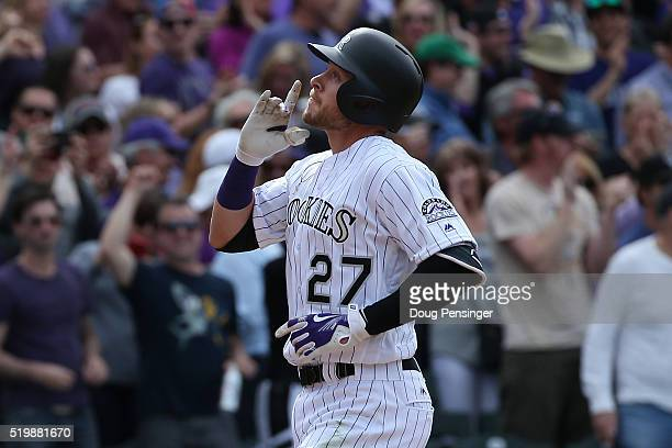 Trevor Story of the Colorado Rockies celebrates his two run home run off of Colin Rea of the San Diego Padres as the Padres held a 65 lead in the...