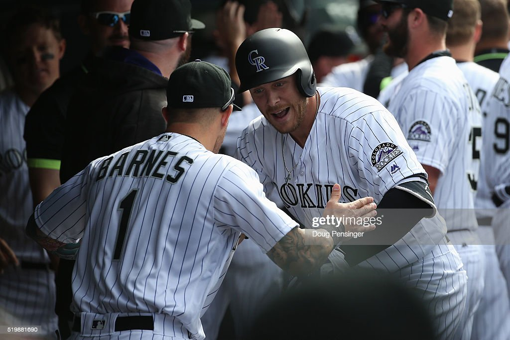 Trevor Story #27 of the Colorado Rockies celebrates his two run home run off of Colin Rea #29 of the San Diego Padres with Brandon Barnes #1 of the Colorado Rockies as the Padres held a 6-5 lead in the fourth inning during opening day at Coors Field on April 8, 2016 in Denver, Colorado.