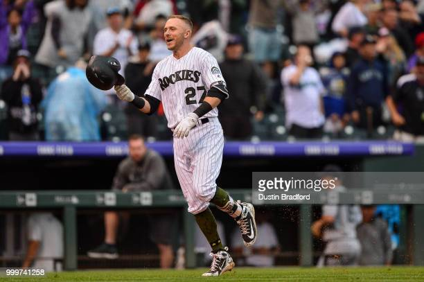 Trevor Story of the Colorado Rockies celebrates on the base paths after hitting a ninthinning walkoff home run against the Seattle Mariners at Coors...
