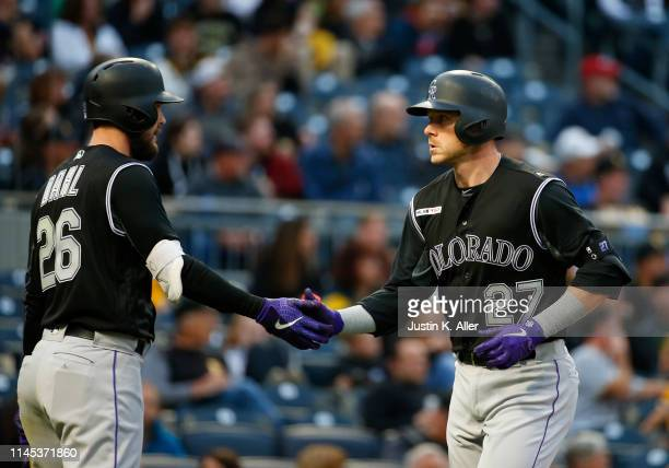 Trevor Story of the Colorado Rockies celebrates with David Dahl of the Colorado Rockies after hitting a home run in the second inning against the...