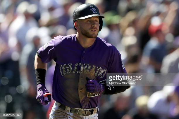 Trevor Story of the Colorado Rockies circles the bases after hitting a 2 RBI home run in the third inning against the Arizona Diamondbacks at Coors...
