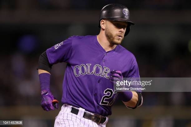 Trevor Story of the Colorado Rockies circles the bases after hitting a 2 RBI home run in the fifth inning against the Philadelphia Phillies at Coors...