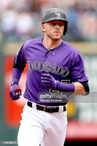 Trevor Story of the Colorado Rockies circles the bases after hitting a 2 RBI home run in the first inning against the San Francisco Giants at Coors...