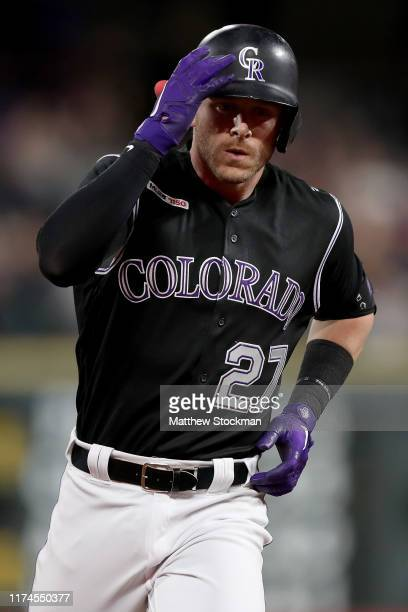Trevor Story of the Colorado Rockies circles the bases after hitting his second home run of the game in the sixth inning against the San Diego Padres...