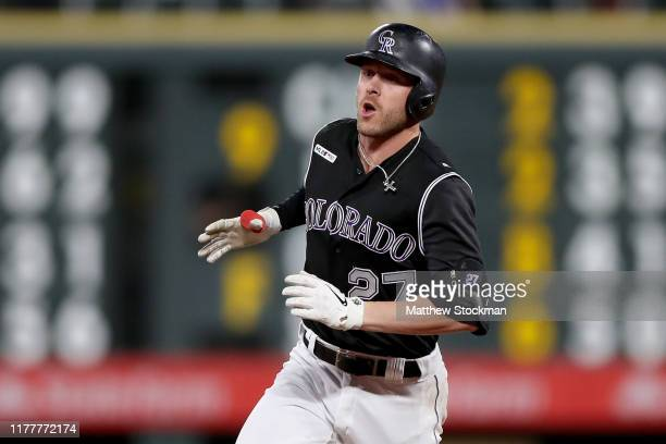 Trevor Story of the Colorado Rockies circles the bases after hitting a walk off home in the tenth inning against the Milwaukee Brewers at Coors Field...