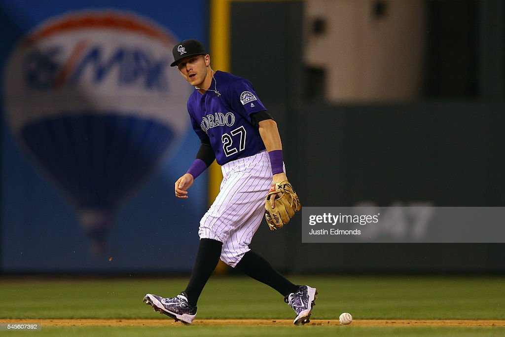 Trevor Story #27 of the Colorado Rockies commits a fielding error during the during the ninth inning against the Philadelphia Phillies at Coors Field on July 8, 2016 in Denver, Colorado. The Phillies defeated the Rockies 5-3.