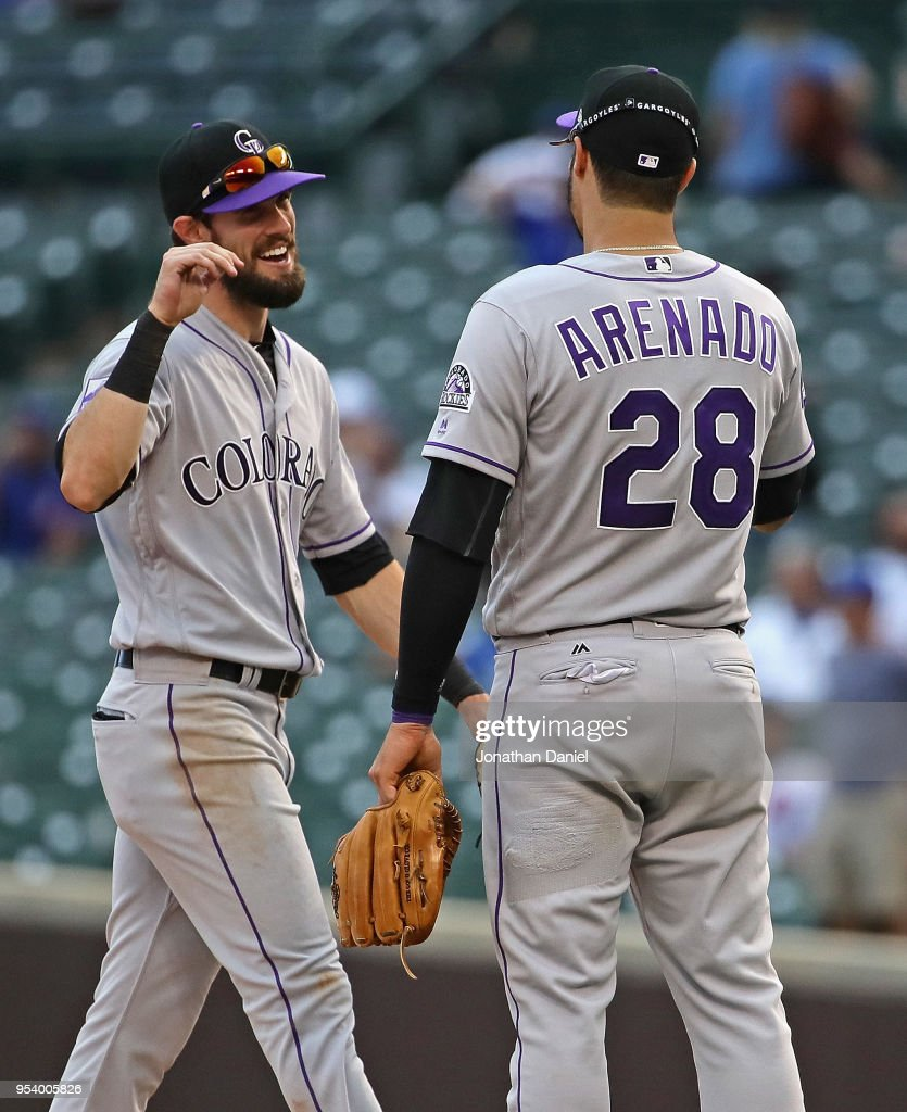 Trevor Story #27 of the Colorado Rockies congratulates Nolan Arenado #28 after a win against the Chicago Cubs at Wrigley Field on May 2, 2018 in Chicago, Illinois. The Rockies defeated the Cubs 11-2.