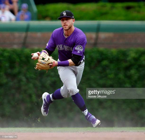 Trevor Story of the Colorado Rockies fields a ball hit by Kyle Schwarber of the Chicago Cubs during the first inning at Wrigley Field on June 06 2019...