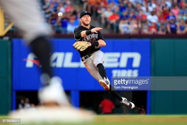 Trevor Story of the Colorado Rockies fields a ground ball hit by Isiah KinerFalefa of the Texas Rangers in the bottom of the third inning at Globe...