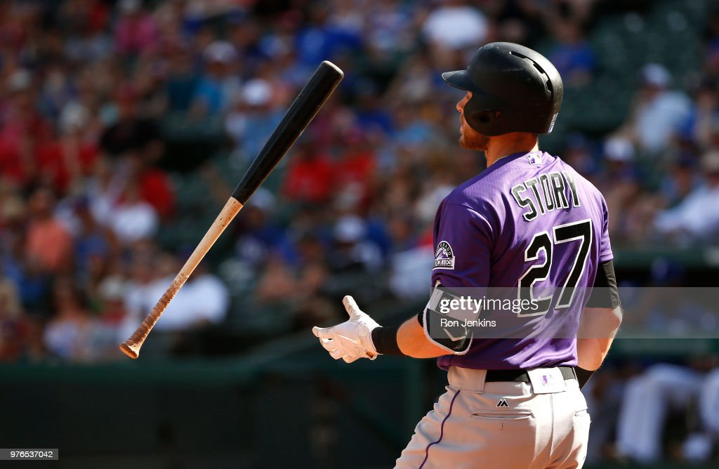 Trevor Story #27 of the Colorado Rockies flips his bat after striking out against the Texas Rangers during the eighth inning at Globe Life Park in Arlington on June 16, 2018 in Arlington, Texas. The Rangers won 5-2.