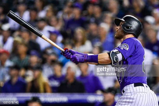 Trevor Story of the Colorado Rockies follows the flight of a three run homerun against the Arizona Diamondbacks in the fifth inning of a game at...