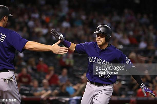 Trevor Story of the Colorado Rockies highfives DJ LeMahieu after hitting a tworun home run against the Arizona Diamondbacks during the first inning...