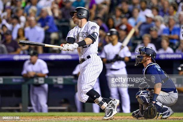 Trevor Story of the Colorado Rockies hits a 2run double in the sixth inning of a game against the Seattle Mariners at Coors Field on July 13 2018 in...