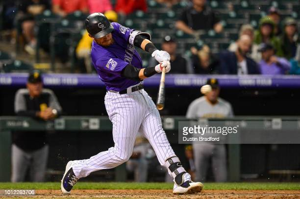 Trevor Story of the Colorado Rockies hits a fifth inning single against the Pittsburgh Pirates to advance a runner from first to third base at Coors...