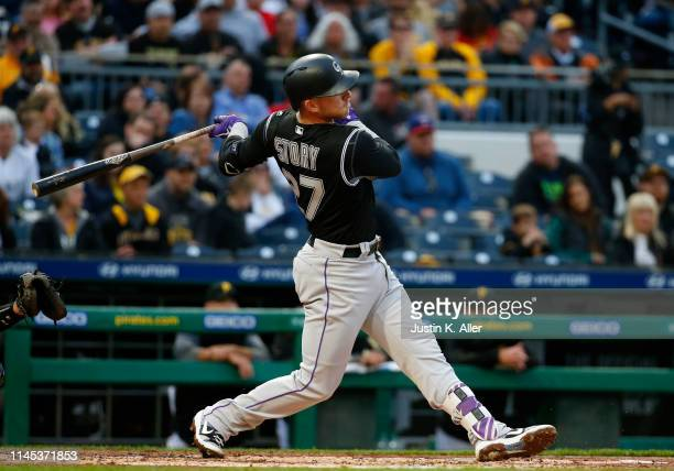 Trevor Story of the Colorado Rockies hits a home run in the second inning against the Pittsburgh Pirates at PNC Park on May 21, 2019 in Pittsburgh,...