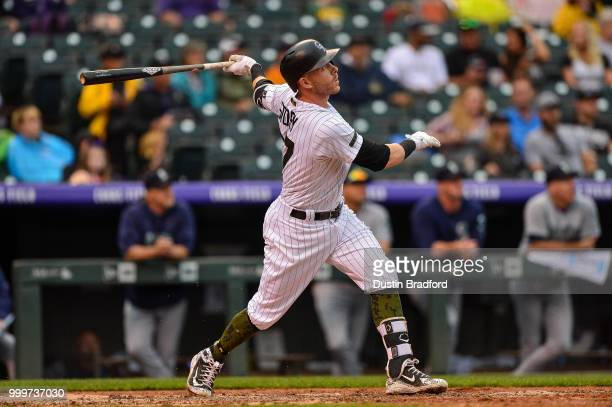 Trevor Story of the Colorado Rockies hits a ninthinning walkoff home run against the Seattle Mariners at Coors Field on July 15 2018 in Denver...
