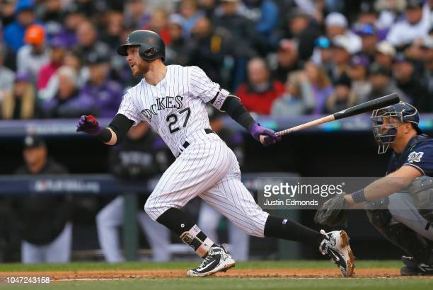 Trevor Story of the Colorado Rockies hits a single in the second inning of Game Three of the National League Division Series against the Milwaukee...