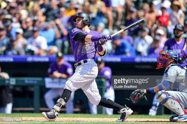 Trevor Story of the Colorado Rockies hits a sixth inning single against the Los Angeles Dodgers at Coors Field on August 12 2018 in Denver Colorado