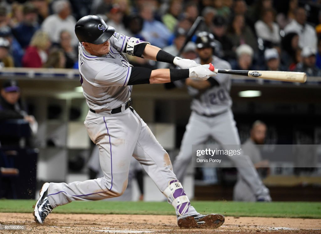 Trevor Story #27 of the Colorado Rockies hits a solo home run during the seventh inning of a baseball game against the San Diego Padres at PETCO Park on September 22, 2017 in San Diego, California.