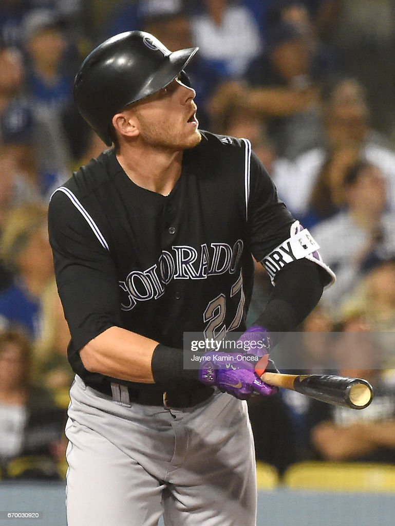 Trevor Story #27 of the Colorado Rockies hits a solo home run in the fourth inning of the game against the Los Angeles Dodgers at Dodger Stadium on April 18, 2017 in Los Angeles, California.