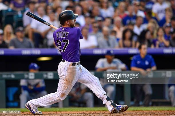 Trevor Story of the Colorado Rockies hits a third inning RBI double against the Los Angeles Dodgers at Coors Field on August 10 2018 in Denver...
