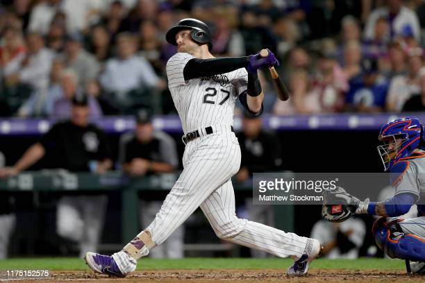 Trevor Story of the Colorado Rockies hits a three RBI home run in the fourth inning against the New York Mets at Coors Field on September 16 2019 in...
