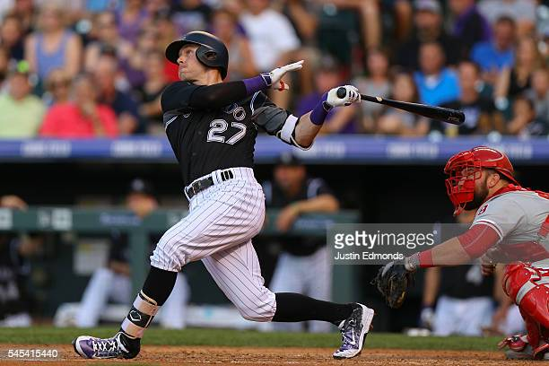 Trevor Story of the Colorado Rockies hits a three run home run during the third inning against the Philadelphia Phillies at Coors Field on July 7...