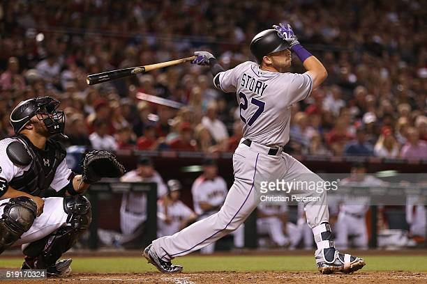 Trevor Story of the Colorado Rockies hits a threerun home run against the Arizona Diamondbacks during the third inning of the MLB opening day game at...