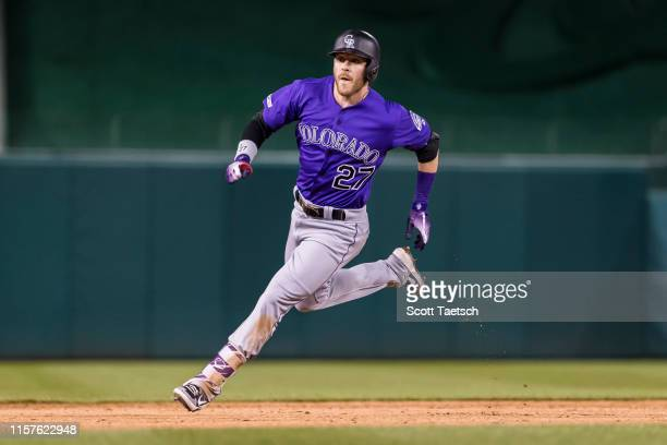 Trevor Story of the Colorado Rockies hits a triple against the Washington Nationals for his 500th hit during the third inning of game two of a...