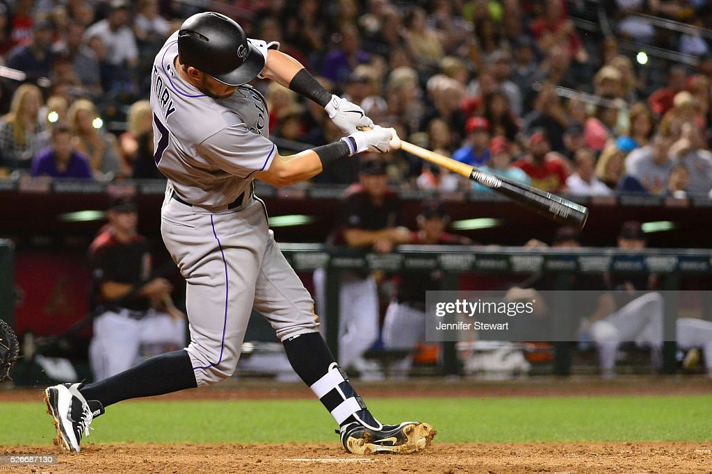 Trevor Story #27 of the Colorado Rockies hits a two run RBI triple in the ninth inning against the Arizona Diamondbacks at Chase Field on April 30, 2016 in Phoenix, Arizona.