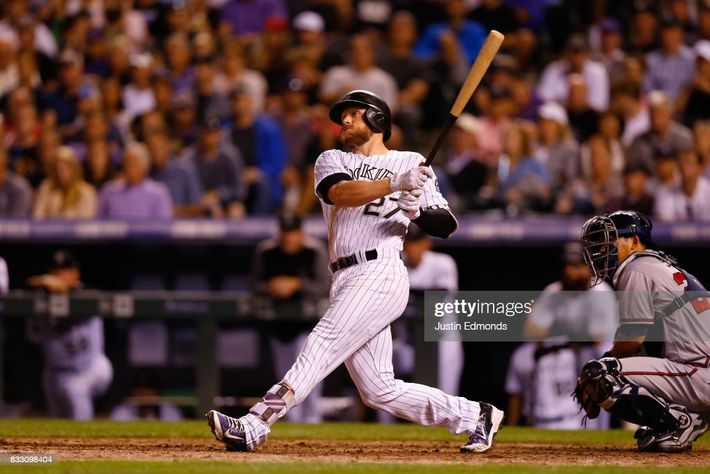 Trevor Story #27 of the Colorado Rockies hits a two-run home run during the fourth inning against the Atlanta Braves at Coors Field on August 16, 2017 in Denver, Colorado.